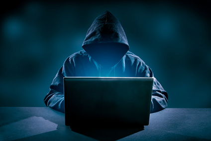 Hacker using laptop